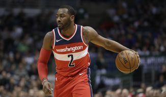 Washington Wizards' John Wall drives during the first half of an NBA basketball game against the Milwaukee Bucks Monday, Nov. 20, 2017, in Milwaukee. (AP Photo/Morry Gash)