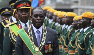 FILE- In this Tuesday, Oct. 6, 2009 file photo, Zimbabwe's President Robert Mugabe inspects the guard of honour during the official opening of the second session of the seventh parliament of Zimbabwe in Harare. Zimbabwe's Parliament erupted in cheers Tuesday Nov. 21, 2017 after the speaker announced the resignation of President Robert Mugabe after 37 years in power. (AP Photo/Tsvangirayi Mukwazhi, File)