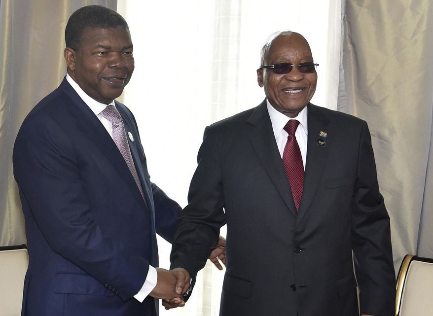In this photo supplied by South African Communication and Information Services (GCIS), Angolan President Joao Lourenco, left, and his South African counterpart Jacob Zuma, meet in Luanda, Angola, Tuesday, Nov. 21 2017.  Zuma is in Angola as head of the inter-governmental organization SADC (Southern African Development Community) to discuss the situation in Zimbabwe.  (Elmond Jiyane, GCIS, via AP)