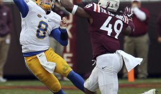 FILE - In this Nov. 18, 2017, file photo, Virginia Tech linebacker Tremaine Edmunds (49) rushes Pittsburgh quarterback Kenny Pickett (8) in the second half of an NCAA college football game in Blacksburg, Va. The junior is one of five finalists for the Butkus Award, which goes to the top linebacker in the country.  (Matt Gentry/The Roanoke Times via AP, File)