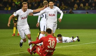Tottenham's Son Heung-min, right, celebrates after scoring his side's second goal during the soccer Champions League group H match between Borussia Dortmund and Tottenham Hotspur in Dortmund, Germany, Tuesday, Nov. 21, 2017. (AP Photo/Martin Meissner)