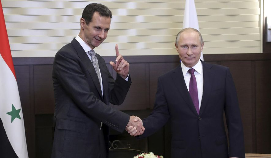"Russian President Vladimir Putin (right) met Monday with Syrian President Bashar Assad, who thanked him for ""saving Syria"" with the help of the Russian military. (Associated Press)"
