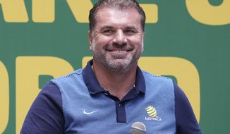 Australian soccer team head coach Ange Postecoglou smiles during a reception following their qualification to the 2018 soccer World Cup in Sydney, Australia, Thursday, Nov. 16, 2017. Australia's 3-1 victory over Honduras secured the next-to-last spot in the World Cup in Russia. (AP Photo/Rick Rycroft)