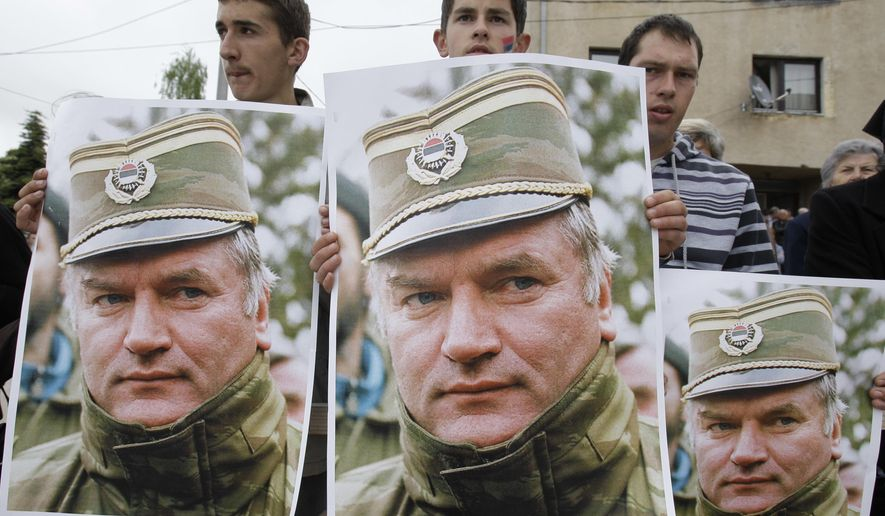 A May 29, 2011 file photo shows Bosnian Serb protesters holding posters depicting former Bosnian Serb army chief Ratko Mladic, during a protest in Mladic's hometown of Kalinovik, Bosnia-Herzegovina. (AP Photo/Amel Emric, File)