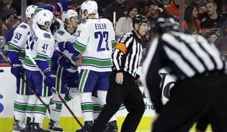 Vancouver Canucks' Brock Boeser (6) celebrates with his teammates after scoring a goal during the first period of an NHL hockey game against the Philadelphia Flyers, Tuesday, Nov. 21, 2017, in Philadelphia. Vancouver won 5-2. (AP Photo/Matt Slocum)