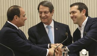 Cyprus President Nicos Anastasiades, center, Greek Prime minister Alexis Tsipras, right, and Egypt's President Abdel-Fattah el-Sissi, shake hands after their meeting at the presidential palace in capital Nicosia, Cyprus, on Tuesday, Nov. 21, 2017.  The leaders of Cyprus, Egypt and Greece meet in the Cypriot capital for talks on forging closer ties and boosting cooperation on issues including energy following the discovery of gas deposits in the east Mediterranean. (AP Photo/Petros Karadjias)