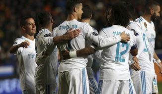 Real Madrid's Cristiano Ronaldo, center, celebrates after scoring the fifth goal of his team during the Champions League Group H soccer match between APOEL Nicosia and Real Madrid at GSP stadium, in Nicosia, on Tuesday, Nov. 21, 2017. (AP Photo/Petros Karadjias)