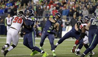 Seattle Seahawks quarterback Russell Wilson (3) passes against the Atlanta Falcons in the second half of an NFL football game, Monday, Nov. 20, 2017, in Seattle. (AP Photo/Ted S. Warren)