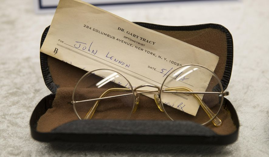 Glasses of John Lennon with a recipe by optometrist Gary Tracy are displayed at the police headquarters in Berlin, Tuesday, Nov. 21, 2017, after German police have arrested a man suspected of handling stolen objects from the estate of John Lennon, including diaries which were stolen from Lennon's widow, Yoko Ono, in New York in 2006. (AP Photo/Markus Schreiber)