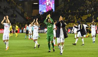 Tottenham players acknowledge the supporters after winning the soccer Champions League group H match between Borussia Dortmund and Tottenham Hotspur in Dortmund, Germany, Tuesday, Nov. 21, 2017. (AP Photo/Martin Meissner)