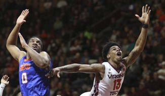 Ahmed Hill (13) of Virginia Tech shoots past Ian Dubose (0) of Houston Baptist in the first half of an NCAA college basketball game in Blacksburg, Va., Tuesday. Nov. 21 2017. (Matt Gentry/The Roanoke Times via AP)