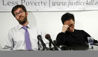 Legal Air Justice Center director Simon Sandoval-Moshenberg, left, and plaintiff Nurimaro Park, 26-year-old resident of Fairfax, Va., right, pause during a news conference at the Legal Aid Justice Center in Falls Church, Va., Tuesday, Nov. 21, 2017, to announce that Park and plaintiff Jonathan Alvarenga Recinos, 19-year-old resident of Alexandria, Va., have filed a lawsuit seeking to have their Deferred Action for Childhood Arrivals, DACA, reinstated and extended for two years. (AP Photo/Carolyn Kaster)