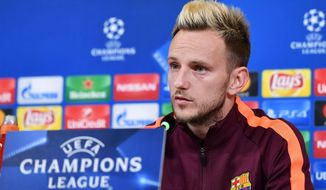 Barcelona's Ivan Rakitic attends a press conference ahead of Wednesday's Champions League soccer match against Juventus, at the Allianz Stadium in Turin, Italy, Tuesday, Nov. 21, 2017. (Alessandro Di Marco/ANSA via AP)