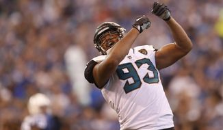 FILE- This Oct. 22, 2017, file photo shows Jacksonville Jaguars defensive end Calais Campbell (93) celebrating a sack against the Indianapolis Colts during the second half of an NFL football game in Indianapolis. Campbell has two things he wants to bring back from Arizona: An eighth victory and Larry Fitzgerald's No. 11 jersey. One is much more important to him than the other. Campbell will return to the place where he spent the previous nine seasons when the Jacksonville Jaguars (7-3) play the Cardinals (4-6) on Sunday, Nov. 26, 2017.   (AP Photo/Jeff Roberson, File)