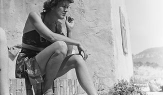"In this 1950 photo provided by Thames and Hudson, is Julia Child in Cassis, France that is part of the exhibit, ""France is a Feast - The Photographic Journey of Paul and Julia Child,"" at the Napa Valley Museum in Yountville, Calif. The exhibit features rarely seen photographs by Paul Child taken between 1948 to 1954 when he and Julia Child lived in Paris. (Paul Child/The Schlesinger Library, Radcliffe Institute, Harvard University via AP)"
