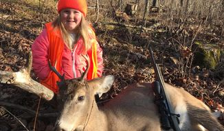 In this Nov. 19, 2017 photo provided by Tyler Harris, Lexie Harris, 6, poses after bagging a buck in Taylor County, Wis. Lexie is among the first youngsters to bag a buck under the state's new law that eliminates the state's minimum hunting age. She is no stranger to the woods. Her dad, Tyler Harris, has taken her hunting since she was three. But, it wasn't until Gov. Scott Walker signed the law on Nov. 12 that Lexie could legally shoot a deer. (Tyler Harris via AP)