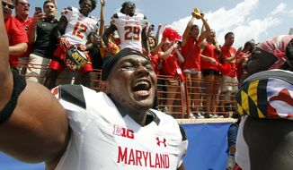 FILE - In this Sept. 2, 2017, file photo, Maryland's Jermaine Carter, Jr. front, celebrates with teammates and fans after defeating Texas in an NCAA college football game in Austin, Texas. Maryland senior linebacker Jermaine Carter Jr. on Saturday will wrap up an outstanding college career that featured impressive personal numbers but not enough wins to make it fully satisfying.  (AP Photo/Michael Thomas, File) **FILE**