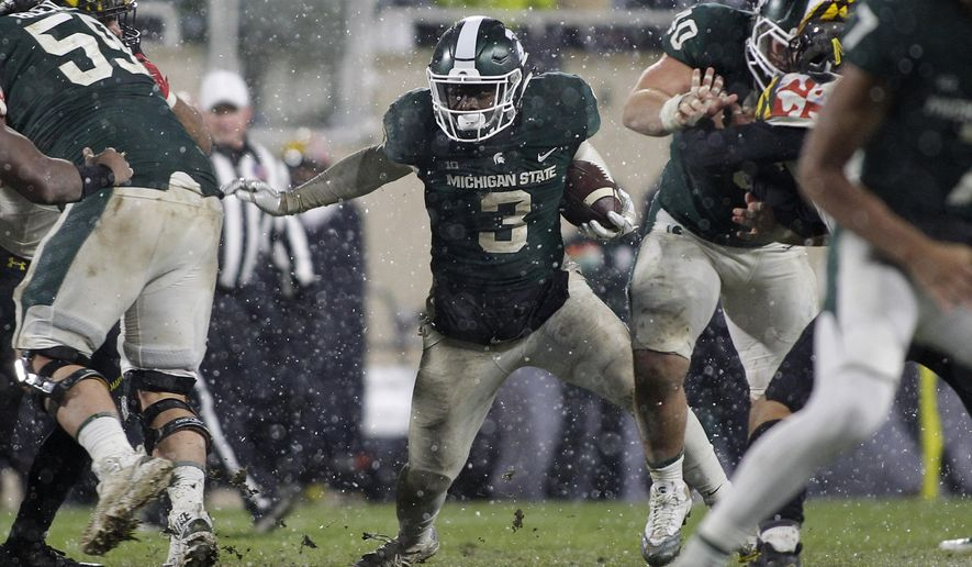 Michigan State's LJ Scott (3) rushes against Maryland during the second half of an NCAA college football game, Saturday, Nov. 18, 2017, in East Lansing, Mich. Michigan State won 17-7. (AP Photo/Al Goldis)