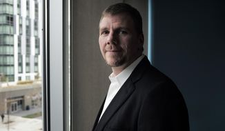 In this Wednesday, Nov. 15, 2017, photo, Brad Sippy, chief executive officer of Tremeau Pharmaceuticals, Inc., stands for a portrait in Cambridge, Mass. Tremeau Pharmaceuticals, Inc., is a small startup trying to bring the recalled painkiller Vioxx back to the market. (AP Photo/Steven Senne)