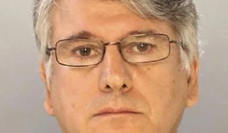 This undated photo provided by the Philadelphia Police Department shows Dr. Ricardo Cruciani, a neurologist charged with groping patients at a Philadelphia clinic. Cruciani is scheduled to appear in court Tuesday, Nov. 21, 2017, on misdemeanor charges that include indecent assault. (Philadelphia Police Department/NJ Advance Media via AP)