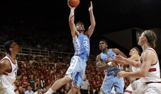 North Carolina forward Luke Maye, center, shoots against Stanford during the first half of an NCAA college basketball game Monday, Nov. 20, 2017, in Stanford, Calif. (AP Photo/Marcio Jose Sanchez)
