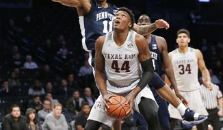 Texas A&M forward Robert Williams (44) looks for an opening with Penn State forward Lamar Stevens (11) defending during the first half of an NCAA college basketball game in the Legends Classic tournament, Tuesday, Nov. 21, 2017, in New York. (AP Photo/Kathy Willens)
