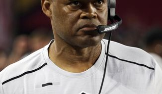 FILE- This Aug. 12, 2017, file photo shows Oakland Raiders coach Ken Norton Jr., prior to an NFL preseason football game in Glendale, Ariz. The Oakland Raiders fired defensive coordinator Norton on Tuesday, Nov. 21, 2017, in a staff shake-up during a disappointing season. Coach Jack Del Rio called the move a difficult decision and said that assistant head coach for defense John Pagano will take over as coordinator leading into this week's home game against the Denver Broncos. (AP Photo/Rick Scuteri, File)