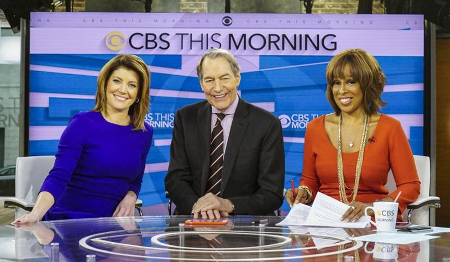 "This image released by CBS shows, from left, Norah O'Donnell, Charlie Rose and Gayle King on the set of ""CBS This Morning."" Rose's co-hosts on ""CBS This Morning"" sharply condemned their suspended colleague Tuesday, Nov. 21, 2017, after the airing of sexual misconduct allegations that included groping female staffers and walking around naked in front of them, saying that it's a time of reckoning in society. (CBS via AP)"