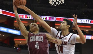 Southern Illinois guard Eric McGill (4) attempts a shot over Louisville forward Anas Mahmoud (14) during the first half of an NCAA college basketball game, Tuesday, Nov. 21, 2017, in Louisville, Ky. (AP Photo/Timothy D. Easley)