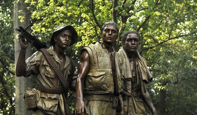 "The 'Three Servicemen Statue"" stands near the Vietnam Veterans War Memorial in Washington, D.C. (Department of Defense photo)"