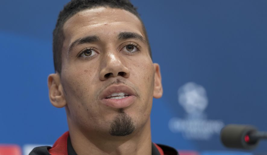Manchester United's Chris Smalling speaks during a press conference the day before the Champions League Group A  soccer match between Switzerland's FC Basel 1893 and England's Manchester United FC at the St. Jakob-Park stadium in Basel, Switzerland, on Tuesday, Nov. 21, 2017. (Georgios Kefalas/Keystone via AP)