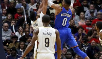 Oklahoma City Thunder guard Russell Westbrook (0) shoots over New Orleans Pelicans forward Anthony Davis (23) as guard Rajon Rondo (9) trails the play in the second half of an NBA basketball game in New Orleans, Monday, Nov. 20, 2017. The Pelicans won 114-107. (AP Photo/Scott Threlkeld)