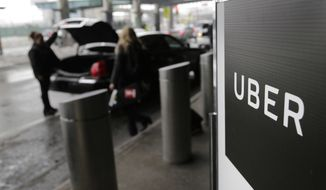 In this March 15, 2017, file photo, a sign marks a pick-up point for the Uber car service at LaGuardia Airport in New York. Uber is coming clean about its cover-up of a year-old hacking attack that stole personal information about more than 57 million of the beleaguered ride-hailing service's customers and drivers. The revelation Tuesday marks the latest stain on Uber's reputation. (AP Photo/Seth Wenig, File)