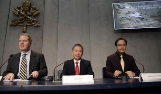 From left, Vatican's spokesman Greg Burke, Secretary General of China Culture Industrial Investment Fund Zhu Jiancheng, and Chinese artist Yan Zhang sit during a press conference at the Vatican, Tuesday, Nov. 21, 2017. The Vatican and China have announced a first-ever exchange of artworks for exhibits in Beijing and the Vatican Museums, as the two states forge ahead with soft diplomacy amid a stalemate in negotiations to heal decades of diplomatic estrangement. (AP Photo/Alessandra Tarantino)