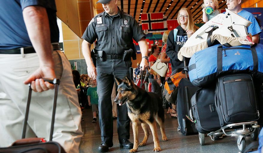 The Transportation Security Administration is deploying more bomb-sniffing K-9s at airports and is on schedule to upgrade carry-on baggage screening to high-tech 3-D imaging machines. (Associated Press/File)