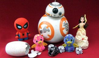 Some of the coolest robots and interactive toy gifts include Sphero's Spider-Man,  Spin Master's Hatchimals Surprise and BB-8, Anki's Cozmo and Hasbro's Princess Belle. (Photograph by Joseph Szadkowski / The Washington Times)