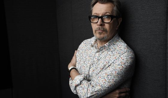 "In this Sept. 12, 2017 photo, actor Gary Oldman, who plays Winston Churchill in the film ""Darkest Hour,"" poses for a portrait during the Toronto International Film Festival in Toronto. (Photo by Chris Pizzello/Invision/AP)"