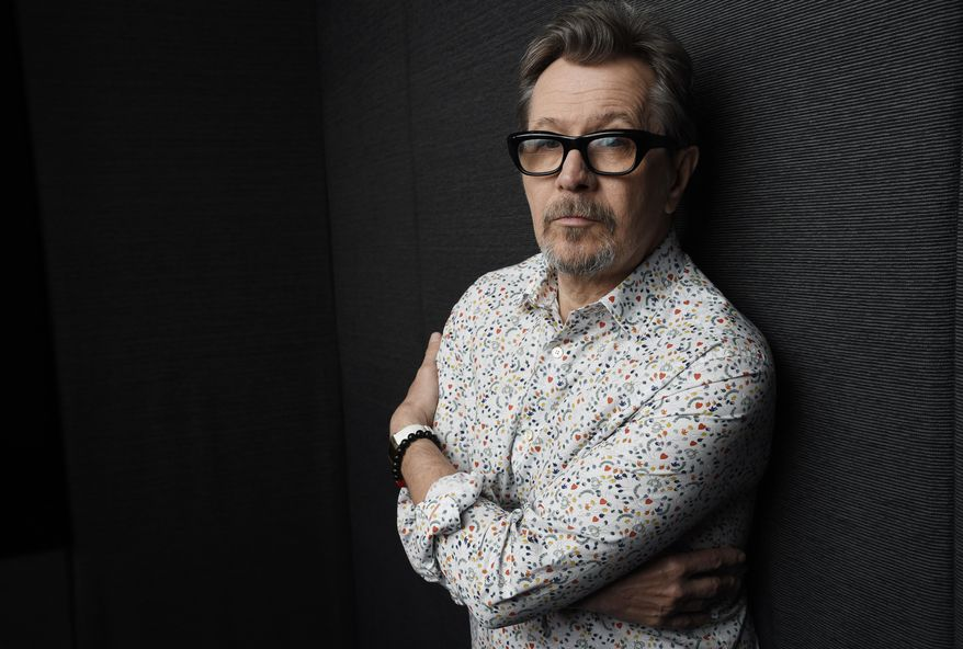 """In this Sept. 12, 2017 photo, actor Gary Oldman, who plays Winston Churchill in the film """"Darkest Hour,"""" poses for a portrait during the Toronto International Film Festival in Toronto. (Photo by Chris Pizzello/Invision/AP)"""