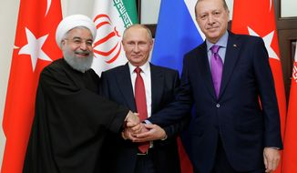 From left, President of Iran Hassan Rouhani, Russian President Vladimir Putin and Turkish President Recep Tayyip Erdogan shake hands at the start of the talks in Russia's Black Sea resort of Sochi, on Wednesday, Nov. 22, 2017. The presidents of Turkey and Iran have hailed their trilateral talks with Russia on Syria's future as critical for restoring peace in the war-torn nation. (Mikhail Klimentyev, Kremlin Pool Photo via AP)