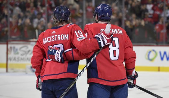 Washington Capitals left wing Alex Ovechkin (8), of Russia, and Washington Capitals center Nicklas Backstrom (19), of Sweden, celebrate Ovechkins' goal during the first period of an NHL hockey game against the Ottawa Senators, Wednesday, Nov. 22, 2017, in Washington. (AP Photo/Nick Wass)