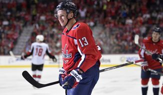 Washington Capitals left wing Jakub Vrana (13), of the Czech Republic, smiles after his goal during the second period of an NHL hockey game against the Ottawa Senators, Wednesday, Nov. 22, 2017, in Washington. (AP Photo/Nick Wass)