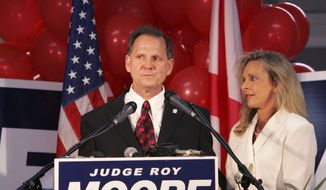 FILE - In this Tuesday, June 6, 2006 file photo, Judge Roy Moore stands with his wife, Kayla, after conceding the governor's race to Gov. Bob Riley, in Gadsden, Ala. (AP Photo/Butch Dill)