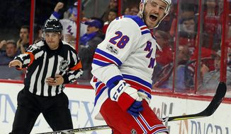 New York Rangers' Paul Carey (28) celebrates his goal during the first period of an NHL hockey game against the Carolina Hurricanes, Wednesday, Nov. 22, 2017, in Raleigh, N.C. (AP Photo/Karl B DeBlaker)
