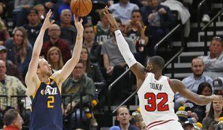 Utah Jazz forward Joe Ingles (2) shoots as Chicago Bulls guard Kris Dunn (32) defends during the first half of an NBA basketball game Wednesday, Nov. 22, 2017, in Salt Lake City. (AP Photo/Rick Bowmer)