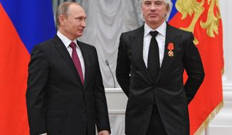 "CORRECTS SPELLING OF NAME  FILE - In this Dec. 10, 2015, file photo, Russian President Vladimir Putin, left, gives a state medal to world-renowned Russian baritone opera singer Dmitry Hvorostovsky during the award ceremony in the Kremlin in Moscow, Russia  Hvorostovsky died after a long battle with cancer. He was 55. Hvorostovsky's office said in a statement Wednesday, Nov. 22, 2017, that the acclaimed singer ""died peacefully"" earlier and was ""surrounded by family"" near his home in London. (Mikhail Klimentyev/Sputnik, Kremlin Pool Photo via AP, File)"