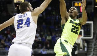 Baylor's King McClure (22) shoots over Creighton's Mitchell Ballock (24) during the first half of an NCAA college basketball game in the Hall of Fame Classic, Tuesday, Nov. 21, 2017, in Kansas City, Mo. (AP Photo/Charlie Riedel)
