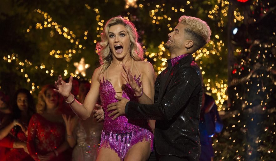 """In this photo provided by ABC, Jordan Fisher, right, and Lindsay Arnold react after being named the champions of """"Dancing with the Stars"""" on Nov. 21, 2017, in Los Angeles. Fisher beat out violinist Lindsey Stirling and actor Frankie Muniz for the Mirrorball Trophy on the season 25 finale of the ABC reality competition. (Eric McCandless/ABC via AP)"""