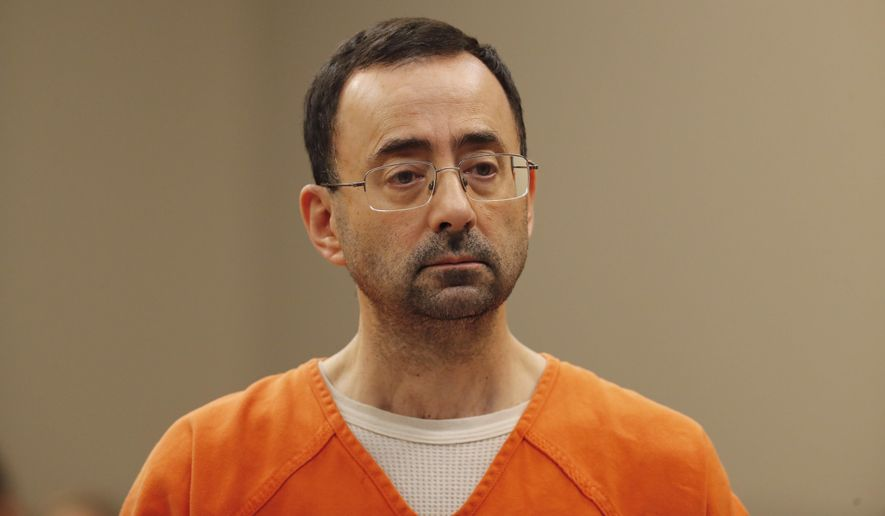 Dr. Larry Nassar, 54, appears in court for a plea hearing in Lansing, Mich., Wednesday, Nov. 22, 2017. Nasser, a sports doctor accused of molesting girls while working for USA Gymnastics and Michigan State University, pleaded guilty to multiple charges of sexual assault and will face at least 25 years in prison. (AP Photo/Paul Sancya) **FILE**