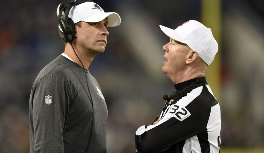 FILE - In this Oct. 26, 2017, file photo, Miami Dolphins head coach Adam Gase, left, speaks with referee John Parry during the second half of an NFL football game against the Baltimore Ravens in Baltimore. The Dolphins rank second in the NFL in penalties and the problem seems to be getting worse, which doesn't help their chances Sunday at New England.  (AP Photo/Gail Burton, File)