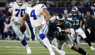 FILE - In this Sunday, Nov. 19, 2017, file photo, Dallas Cowboys quarterback Dak Prescott (4) is sacked by Philadelphia Eagles defensive end Derek Barnett (96) in the first half of an NFL football game in Arlington, Texas. The defending NFC East champs are already all but eliminated in the division race, with a tough road to a wild-card spot as well. (AP Photo/Michael Ainsworth, File)